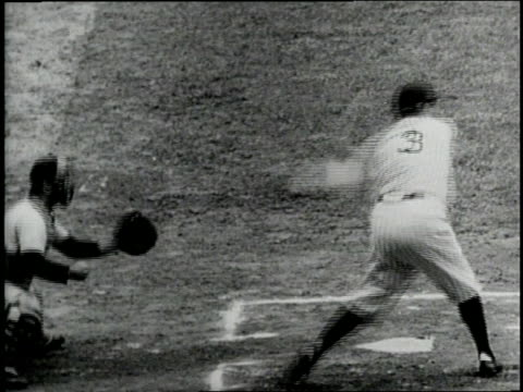 New York Yankees player Babe Ruth swings and misses the ball