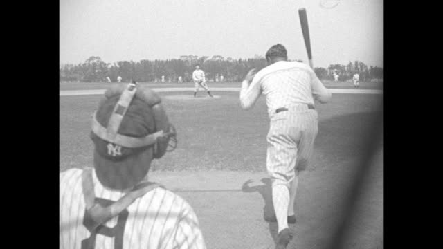 new york yankees player babe ruth swings for a hit during spring training in st. petersburg; view from behind catcher ; view through batterõs cage;... - gabbia di battuta video stock e b–roll