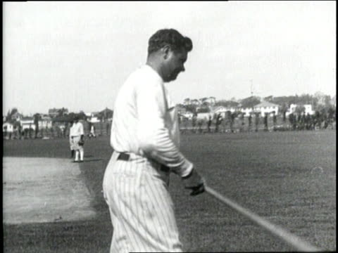 New York Yankees player Babe Ruth swings his bat during practice
