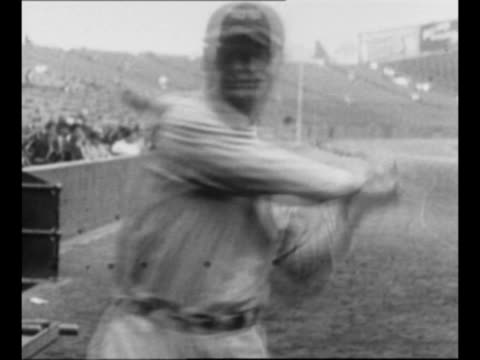 cu new york yankees player lou gehrig speaks chews adjusts hat / gehrig poses with baseball bat swings / gehrig takes a couple pitches while at the... - lou gehrig stock videos & royalty-free footage