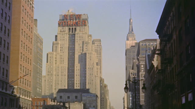1953 montage new yorker building and empire state building in background/ ms top section of new yorker building/ midtown manhattan, new york, usa - 1953 stock videos and b-roll footage