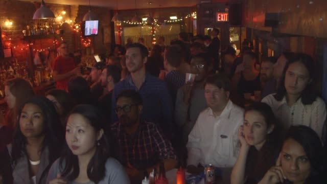 new yorkers cram into an east village bar to watch hillary clinton and donald trump debate terrorism race relations and guns as the pair squares off... - debate stock videos & royalty-free footage