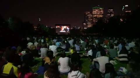 """new yorkers gather in brooklyn bridge park for the annual outdoor movie screening event """"movies with a view"""" which takes place every thursday evening... - film screening stock videos & royalty-free footage"""