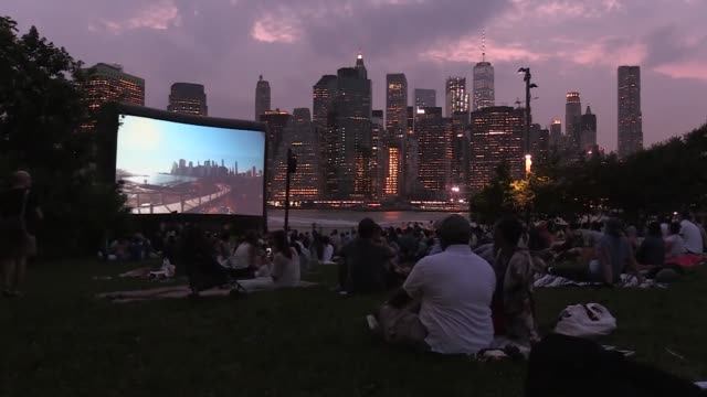 new yorkers gather in brooklyn bridge park for the annual outdoor movie screening event movies with a view which takes place every thursday evening... - film screening stock videos & royalty-free footage