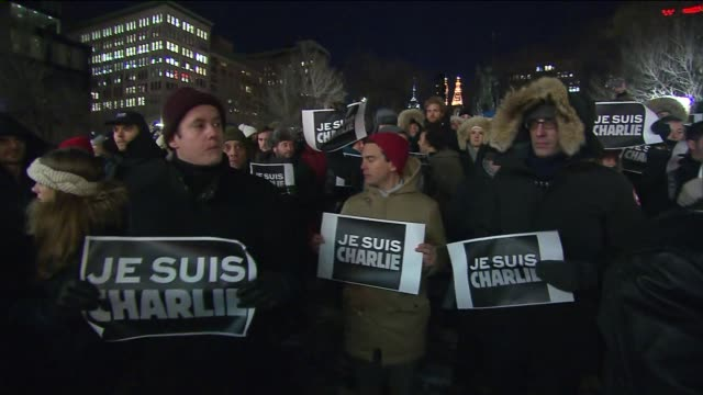 new yorkers gathered in union square wednesday evening in support of french satirical magazine charlie hebdo and its staff, 12 of whom were killed in... - satire stock-videos und b-roll-filmmaterial