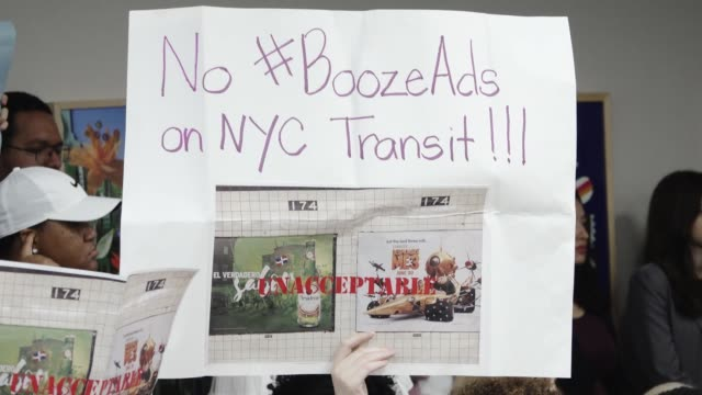 new yorker's gathered outside the new york city transit office at 2 broadway in light of the scheduled mta board meeting that same morning. after the... - fare video stock e b–roll