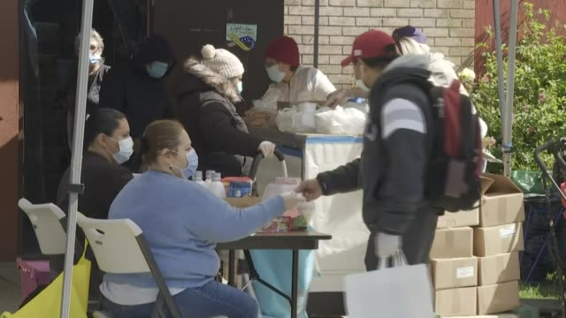 new yorkers line up at a food pantry in the elmhurst neighborhood of queens which was been heavily hit by covid19 as another 243 million us workers... - unemployment stock videos & royalty-free footage