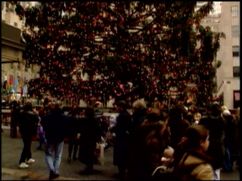 new yorkers share what makes christmas important on december 25 1995 in new york new york - rockefeller center christmas tree stock videos & royalty-free footage