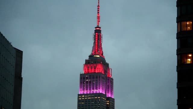 new york's empire state building was lit up in red and purple tuesday in honor of more than 200 nigerian girls kidnapped by boko haram militants one... - heder bildbanksvideor och videomaterial från bakom kulisserna