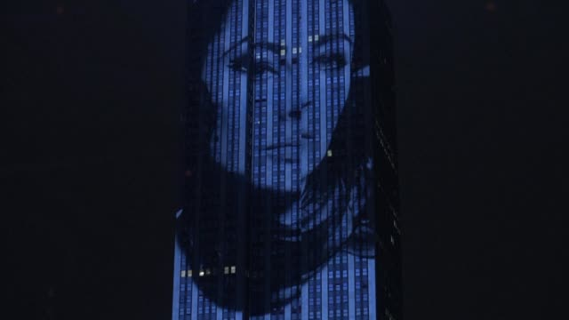 New York's famed Empire State Building lights up with iconic fashion photographs to celebrate the 150th anniversary of style magazine Harper's Bazaar