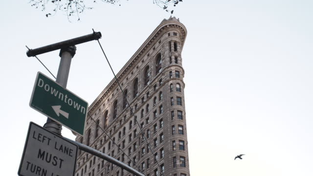 new york's flatiron building on a warm autumn afternoon. - road sign stock videos & royalty-free footage