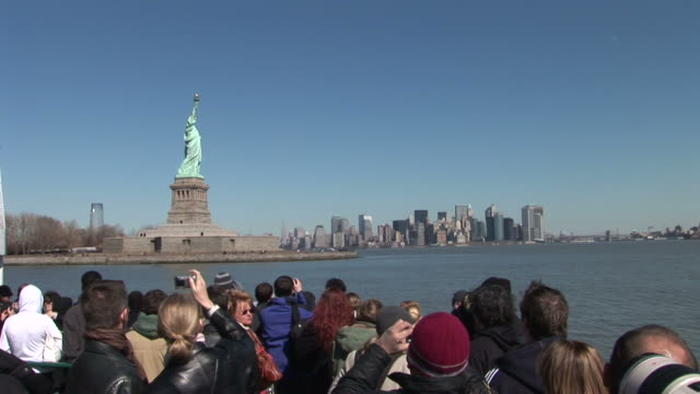 new yorkview of statue of liberty from a ferry in new york united states - statue of liberty new york city stock videos & royalty-free footage