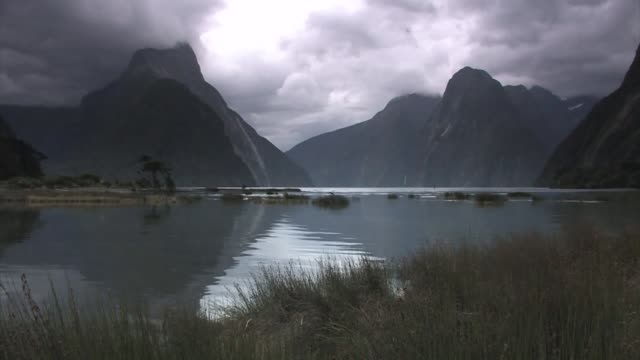 new zealand. clouds over milford sound. - new zealand stock-videos und b-roll-filmmaterial