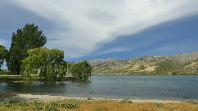 new zealand dark cloud over lake dunstan - coastal feature stock videos & royalty-free footage