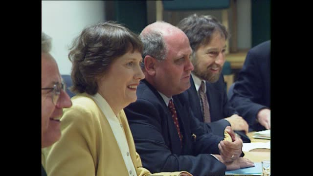 New Zealand First and Labour Party negotiators walk into committee room at Parliament and take their seats around the negotiating table