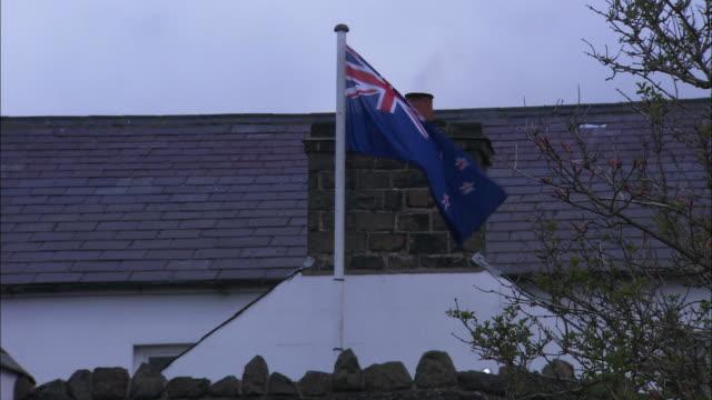 New Zealand flag flies above quaint building in Ireland, Northern Ireland