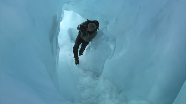 new zealand, franz josef glacier. climbing inside an ice cave. editorial use only. - glacier stock videos & royalty-free footage