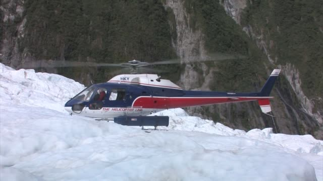 new zealand, franz josef glacier. helicopter lands on ice. editorial use only. - helicopter landing stock videos & royalty-free footage