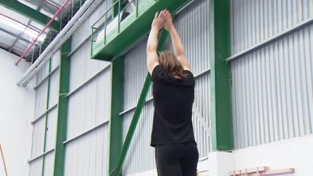 New Zealand Gymnast Stella Ashcroft practising on balance beam gymnastics apparatus