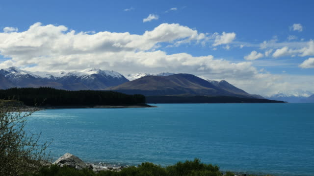 new zealand lake pukaki with clouds - new zealand southern alps stock videos & royalty-free footage