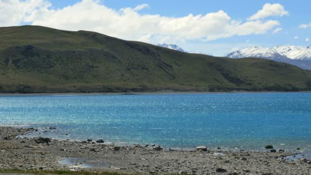 new zealand lake tekapo mountains beyond pan - new zealand southern alps stock videos & royalty-free footage