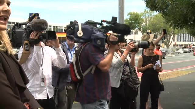 new zealand media gathered outside hamilton district court, waikato, waiting for family of unruly british tourists to emerge, after one member... - paparazzi photographer stock videos & royalty-free footage