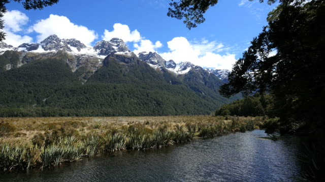 new zealand mirror lakes with mountains fiordland - new zealand点の映像素材/bロール