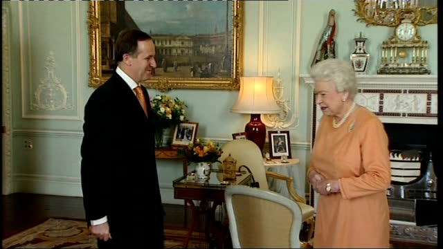 vídeos de stock, filmes e b-roll de new zealand prime minister john key meets queen elizabeth england london buckingham palace int new zealand prime minister john key enters state room... - 2008