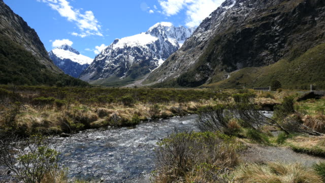 New Zealand river and snow on mountain Fiordland