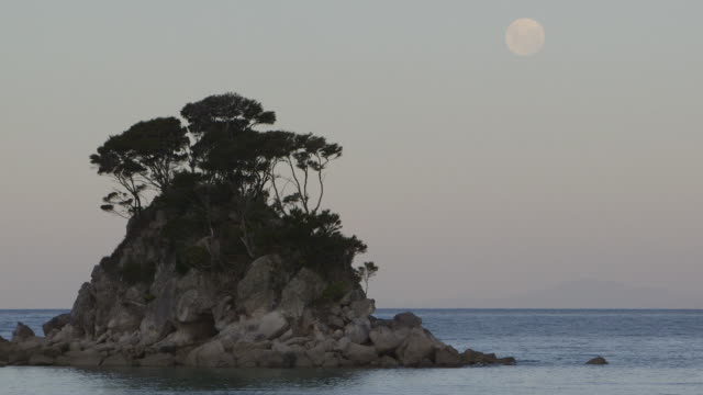 New Zealand small island sunset with moon