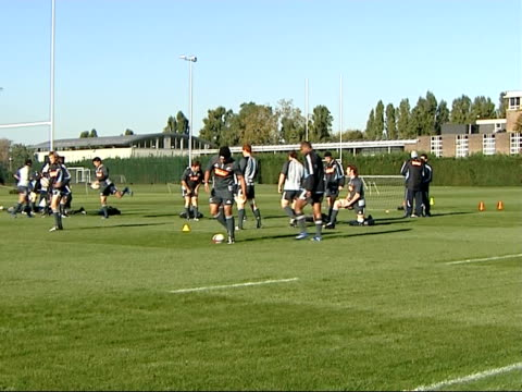 New Zealand's rugby union squad practice ahead of a test match against England More of Henry / Players stretching / General shot of players warming...