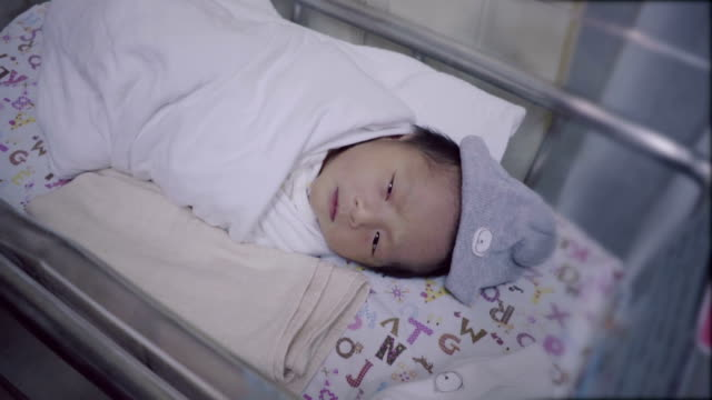 newborn asian baby sleep in incubator with baby blanket. - baby blanket stock videos and b-roll footage