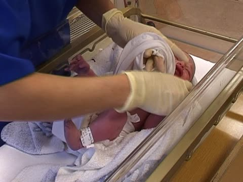 newborn baby 3 - delivery room stock videos and b-roll footage