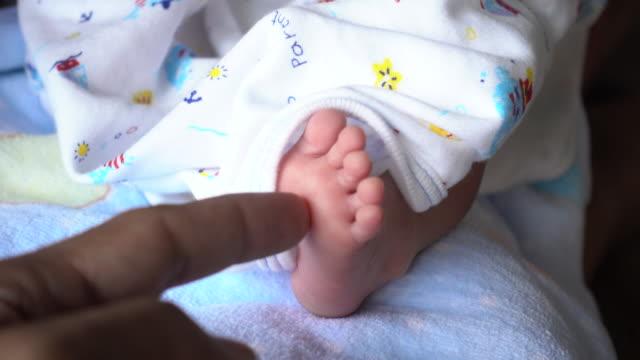 newborn baby and little feet - nursery bedroom stock videos & royalty-free footage