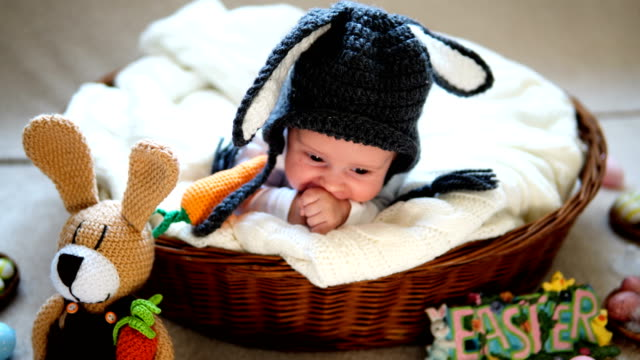 newborn baby boy wearing bunny ears and tail in a basket. - one baby boy only stock videos & royalty-free footage
