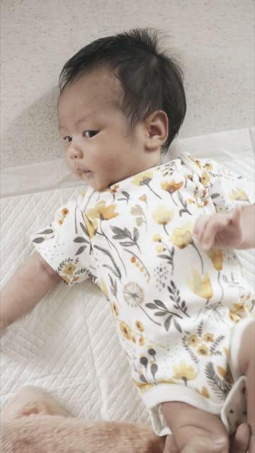 newborn baby girl. - getting dressed stock videos & royalty-free footage
