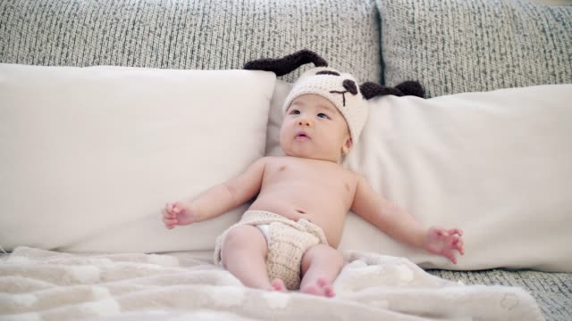 newborn baby happiness at home with family , slow motion - babygro stock videos & royalty-free footage