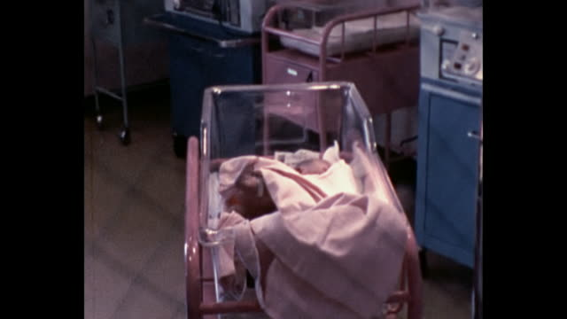 1974 newborn baby in nursery room - baby human age stock videos & royalty-free footage