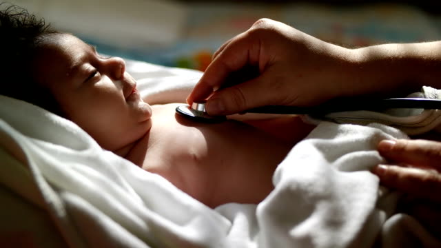 a newborn baby is being given medicine - clinic stock videos and b-roll footage