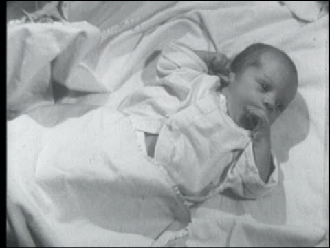 b/w 1955 newborn baby lying in crib - 1955 stock videos & royalty-free footage