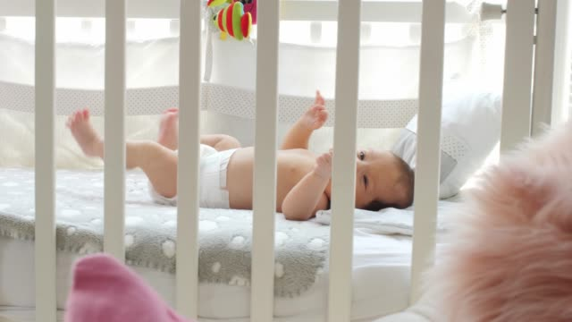 newborn baby lying in the crib and crying for her mother - cot stock videos & royalty-free footage