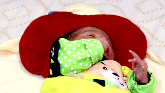 newborn baby playing alone - video portrait stock videos & royalty-free footage
