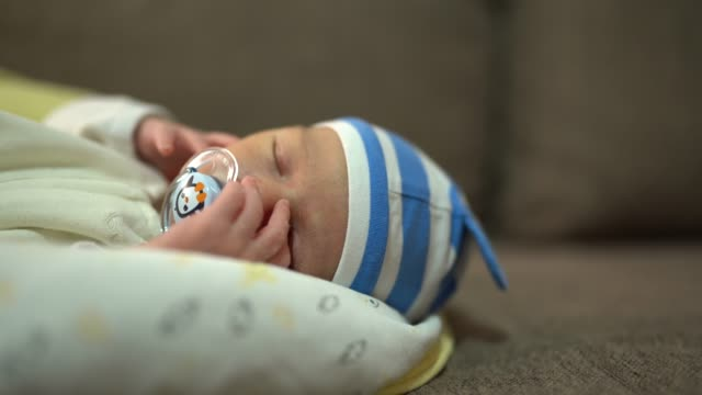 newborn baby sleeping tight - pacifier stock videos and b-roll footage