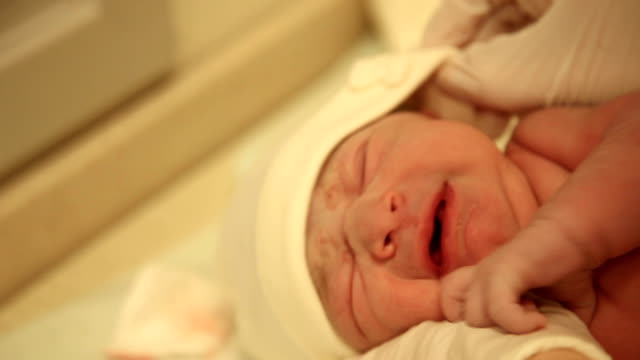 a newborn baby waken a new life - woolly hat stock videos & royalty-free footage