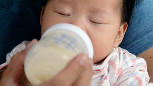 newborn bottle feeding milk - milk bottle stock videos & royalty-free footage