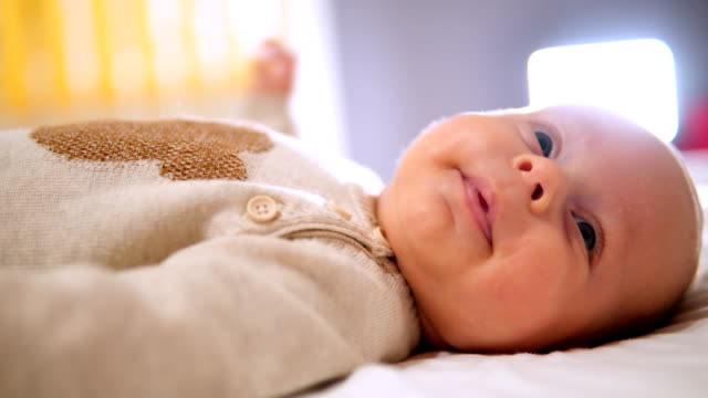 newborn child relaxing in bed. - one baby boy only stock videos & royalty-free footage
