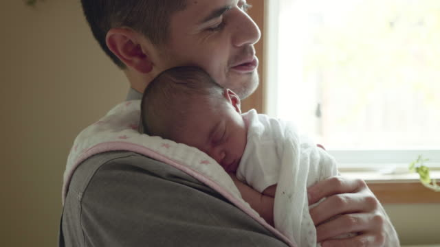 newborn girl asleep on her father's shoulder - young family stock videos & royalty-free footage