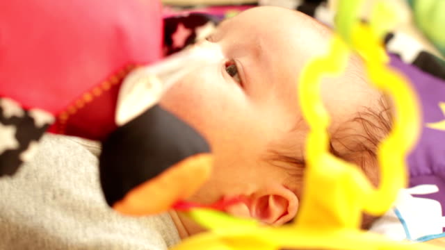 Newborn playing