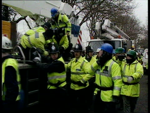 newbury berks gv police in dayglo jackets standing around camp pan rl more ditto and cordon day la demo in tree shelter la another ditto lms digger... - newbury england stock videos & royalty-free footage