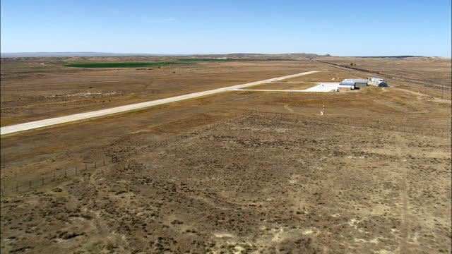 newcastle airfield - aerial view - wyoming, weston county, united states - airfield stock videos & royalty-free footage